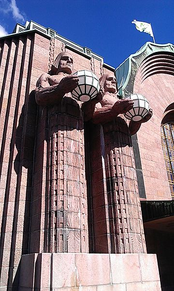 Pink facade of Helsinki Railway Station located in Cancer with Scorpio photo: Ethan_Doyle_White