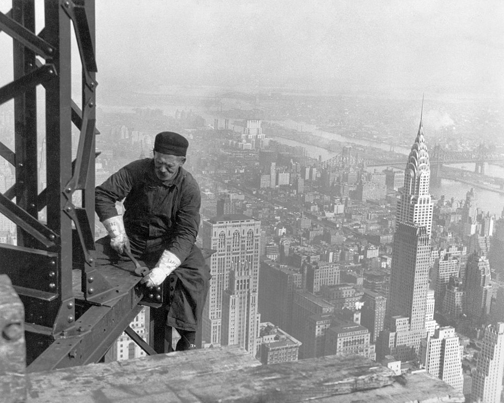 A worker bolts beams during construction of Empire State Building