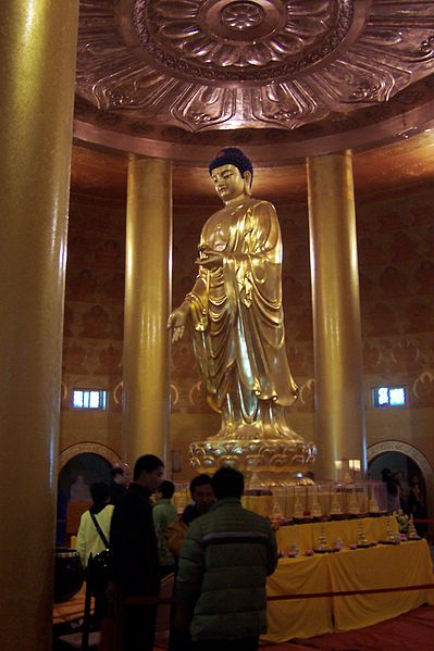Buddha statue inside giant golden Puxian statue on Emei Shan summit   photo:Truthven, ccbysa3.0