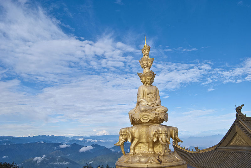 Golden Samanthabhadra statue on top of the temple on Mount Emei located in Scorpio with Aries photo: Cs california ccbysa3.0