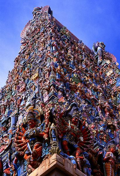 One of the towers (gopuram) at the enwalled meenakshi temple city. The extremely rich bubble-gum coloured ornamentation with sculptures depicting demigods and other spiritual beings photo: NeilsPhotography, ccbysa2.0