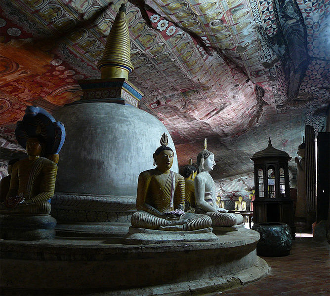 Buddha and stupa at Dambulla cave temple photo: Lankapic