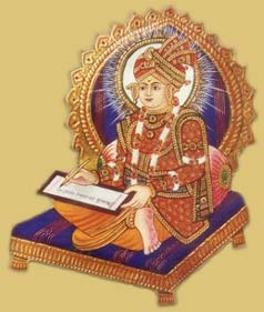 Swaminarayan writing the Shikshapatri. image: Around The Globe, GNU/FDL